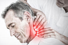 male chiropractor massaging the neck of a patient